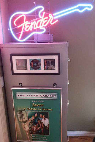 FIling cabinet with Fender sign, poster