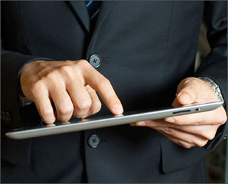 Hands operating a tablet computer