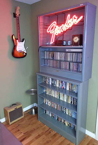 Office bookcase with guitar, fender sign