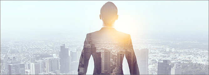 Attorney looking over cityscape with sun on shoulder