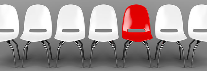 Red chair among white demonstrates uniqueness